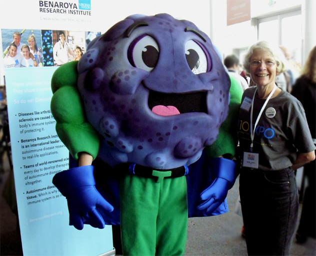 Reitha Weeks, PhD of NWABR visits with Tommy T-cell of BRI at Life Sciences Research Weekend 2010